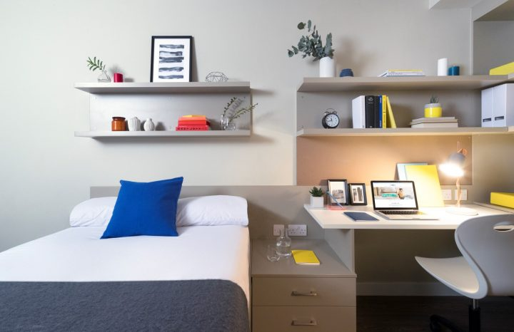 Studio Apartment with bed made up and interior decorations at Melbourne Apartments Urban Study