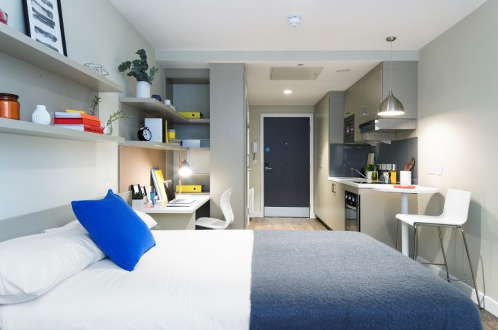 Studio Apartment with bed made up and interior decorations at Jesmond Apartments Urban Study